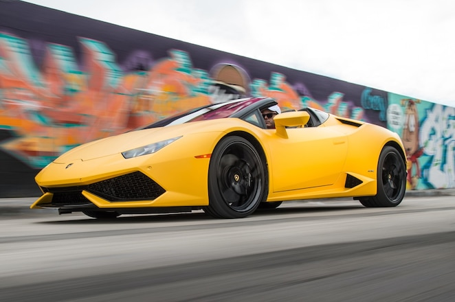 2016 Lamborghini Huracan Spyder front three quarter in motion 18 2