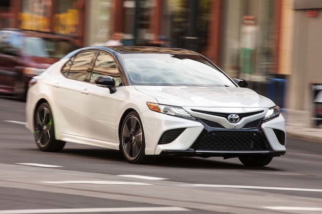 2018 Toyota Camry XSE front three quarter in motion 03