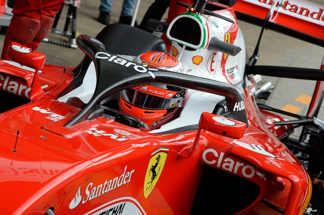 Ferrari F1 car with halo protector and driver Kimi Raikkonen