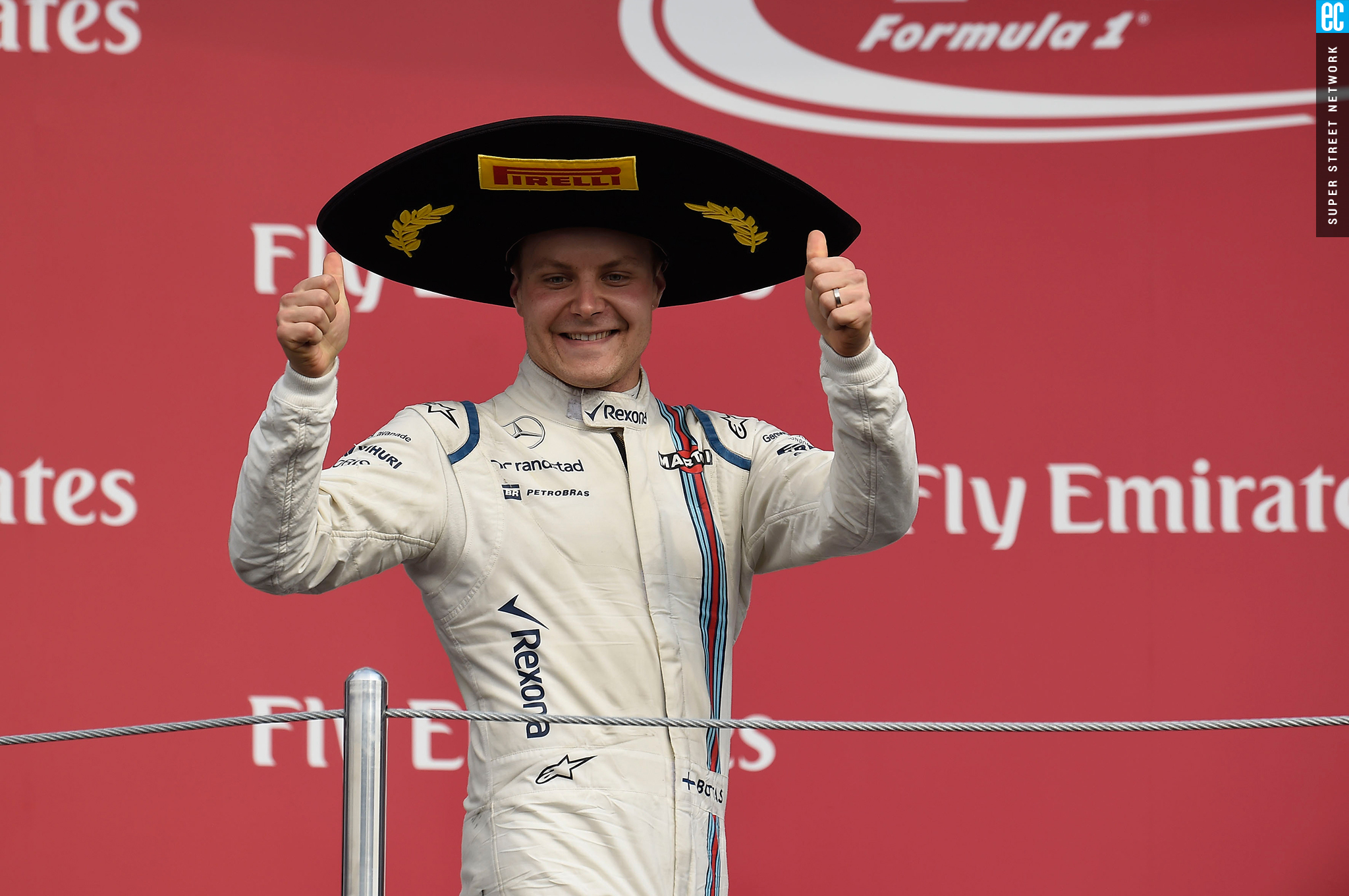 cc9bfeef52249 Mexican grand prix racer wearing pirelli sombrero