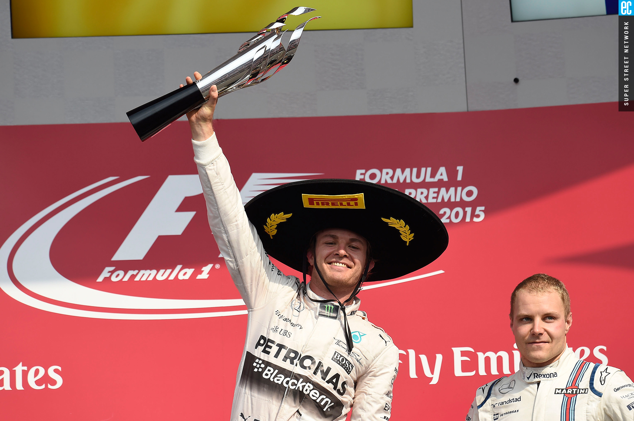 44498f634937e Mexican grand prix race winner wearing pirelli sombrero with trophy