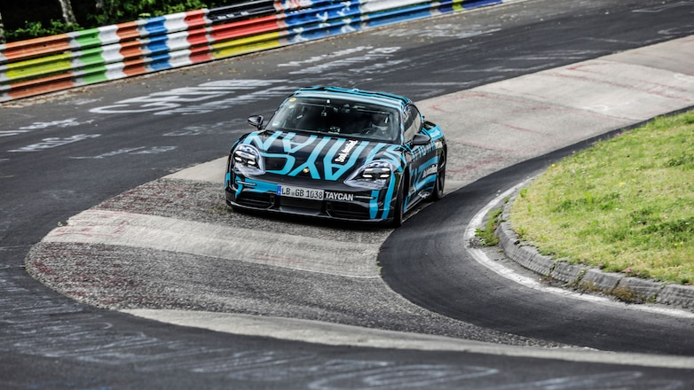 high_taycan_prototype_in_the_karussell_section_nürburgring_nordschleife_2019_porsche_ag