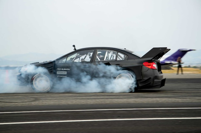 Travis-Pastrana-Gymkhana-Subaru-WRX-STI-Driver-Side-View